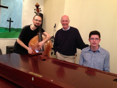 Adam Thomas (bass), Brian Fraser, and Dan Reynolds (piano) prepare for Jazz Evensong.