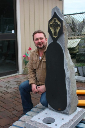 Ves Vukovic with one of his creations at work. He makes gravestones for people who have died without family.