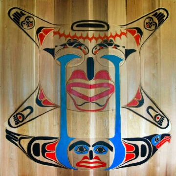 Carved and painted design on red cedar panel by Don Froese, 10 x 10 ft. Completed 2008.