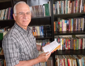 Hanna Atoui scans an Arabic language book, one of hundreds in several languages at the Middle Eastern Friendship Centre. He has been a volunteer at MEFC since it opened.