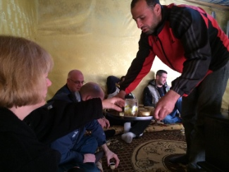 """Hospitality in the Middle East is VERY important,"" says James Grunau.  ""Here we are being served tea by our Syrian host as we visit him and his family in their tent in the refugee settlement in the Bekaa Valley."""