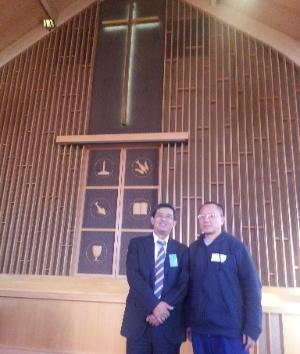 Dr. Yujian Hong (left), senior pastor of Faith Chinese Baptist Church, with Judge Li Jianfeng.