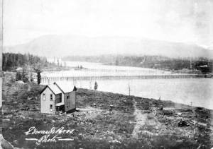 View across False Creek from the Fairview Slopes in 1891. Visible are the original Granville Bridge and the CPR Kitsilano Trestle Bridge. False Creek Indian Reserve is on the left. Photo by Edward Bros. (Vancouver Archives AM54-S4 VPL57.1)
