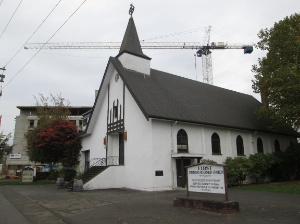 First Christian Reformed Church at 10th and Victoria already plays an active role in the community. The new Immigration Services Society building being built right beside it will no doubt influence the church's activities.
