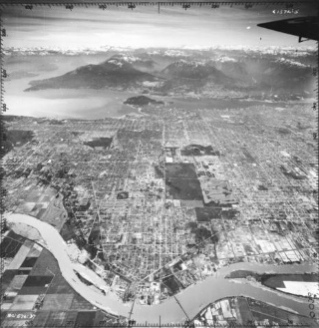 A view of Vancouver from the air in 1948, with Kerrisdale, Marpole, Oakridge and Sunset in the foreground. Note the open land in Oakridge. Vancouver Archives: AM54-S4-: LP 153.2
