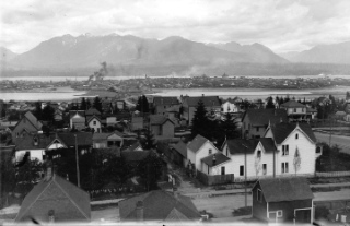 View of Mount Pleasant looking north from Ninth Avenue (Broadway) near Quebec Street, in 1890. Westminster (Main Street) Bridge crossed False Creek, which extended further east than it does today. AM54-S4-: LGN 1052
