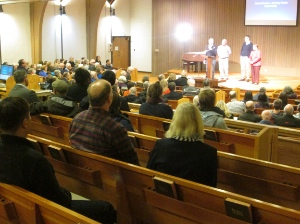 Helen Allen of the United Church with James Grunau, John **** and Chris Friesen.