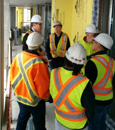 Chris Friesen of ISSofBC gave several pastors, including Trevor Vanderveen of the neighbouring First Vancouver CRC Church, a tour of the new refugee Welcome House.