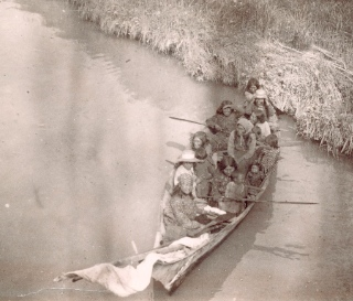 Women and children in dugout canoe on Fraser River. Photo by C.T. Dunbar about 1890. City of Vancouver Archives: AM54-S4-: In P137