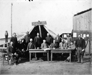 City Council members and officials in front of  'City Hall' after the fire of 1886. Vancouver Archives: AM54-S4-: LGN 456