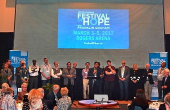 Festival of Hope leaders gathered on the stage at Broadway Church March 31..