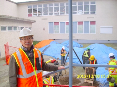 Bill Chu, monitoring the sieving of materials from a minor excavation at the New Westminster Secondary School site in December 2012.