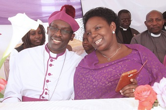 Bishop Fred Sheldon Mwesigwa and his wife ****.
