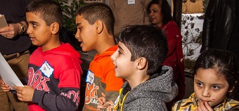 Refugee children sang O Canada at the February 11 *** celebration.