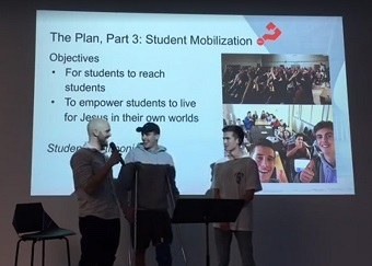 Jonathan Mitchell with two student leaders from Delta. (Image taken from video.)